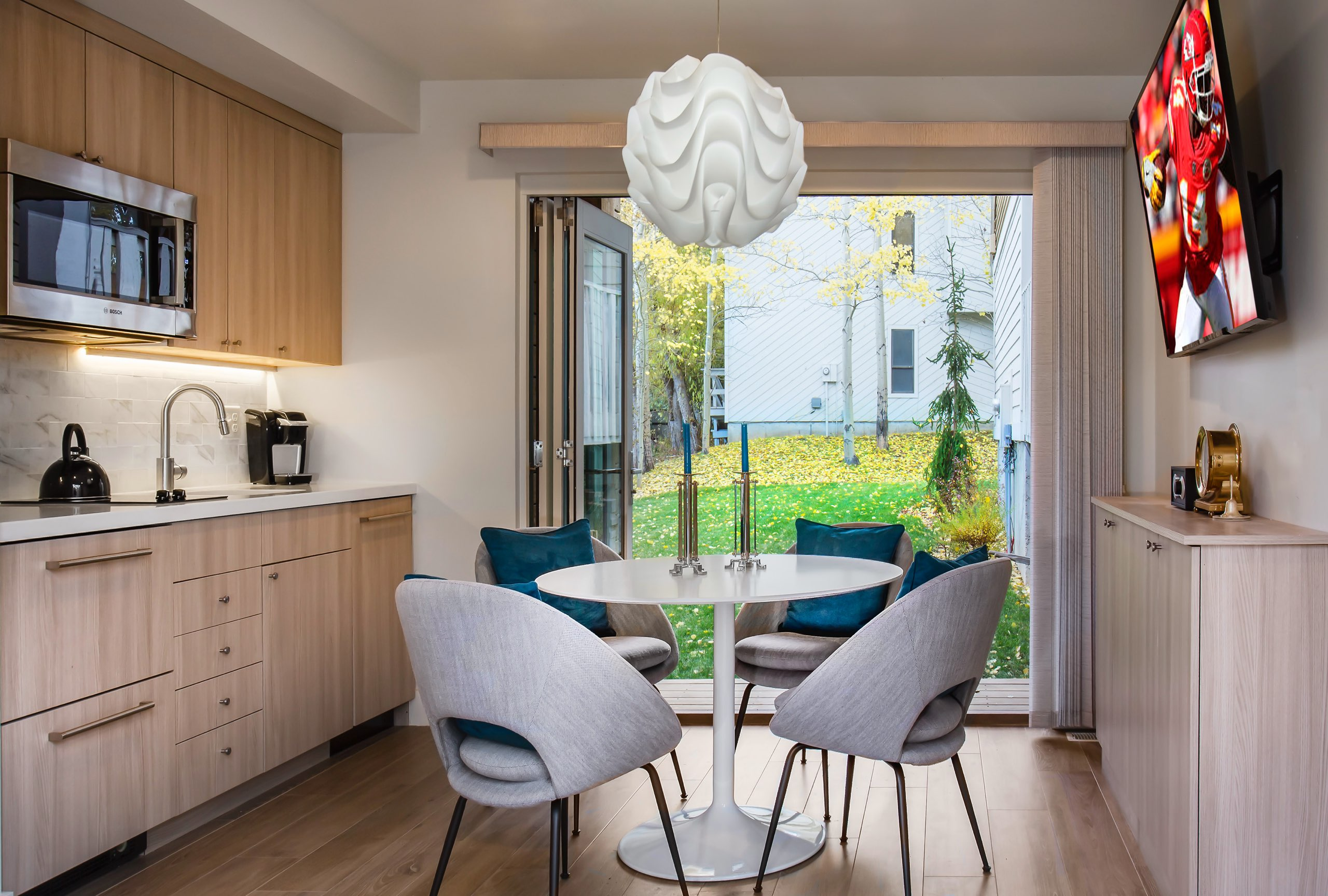 Kitchen and dining room in the Granny Pod in Park City, Utah, architectural design by Elliott Workgroup