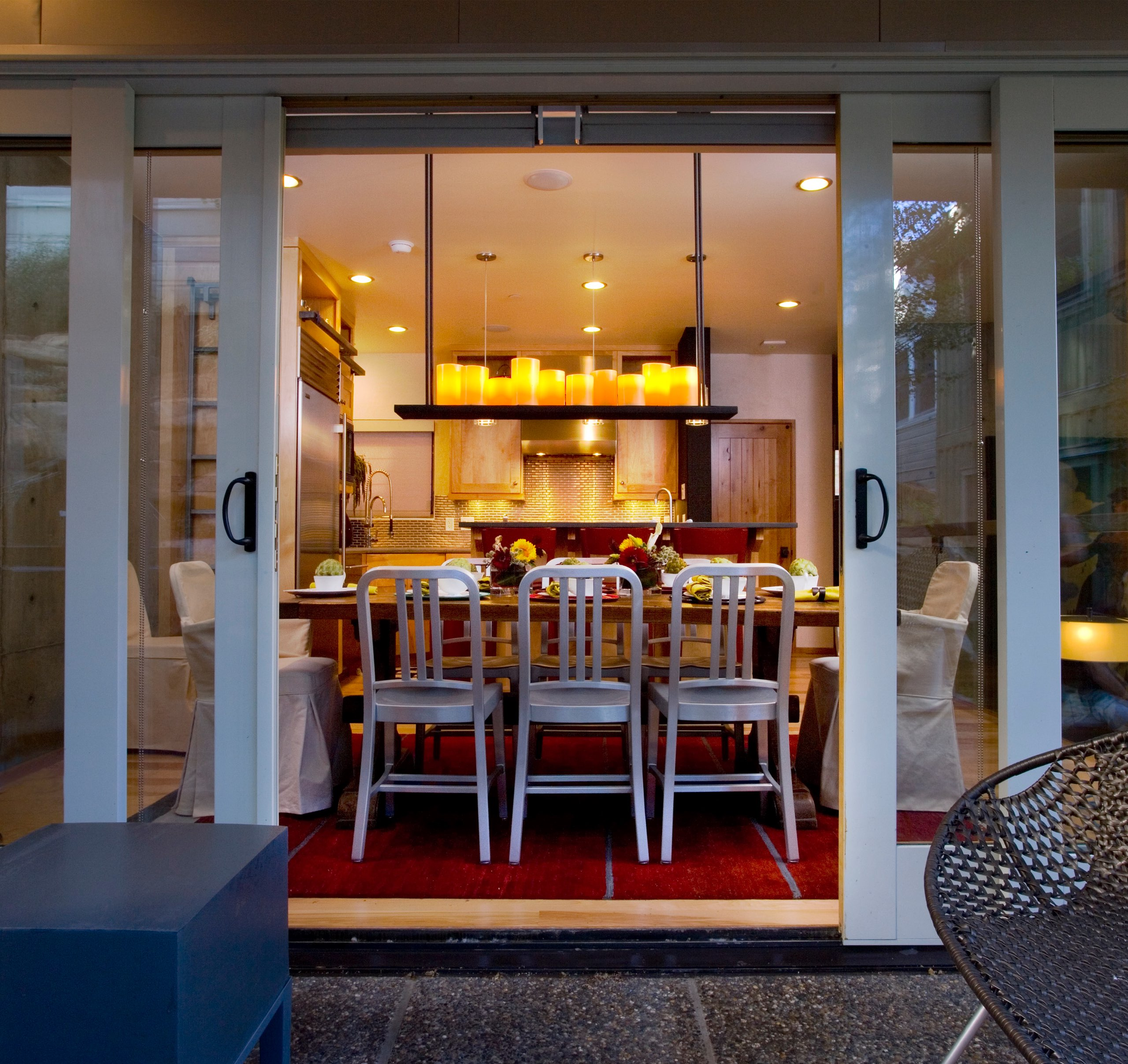 Exterior view of a dining room in Kings Crown Triplex in Park City, Utah, architectural design by Elliott Workgroup