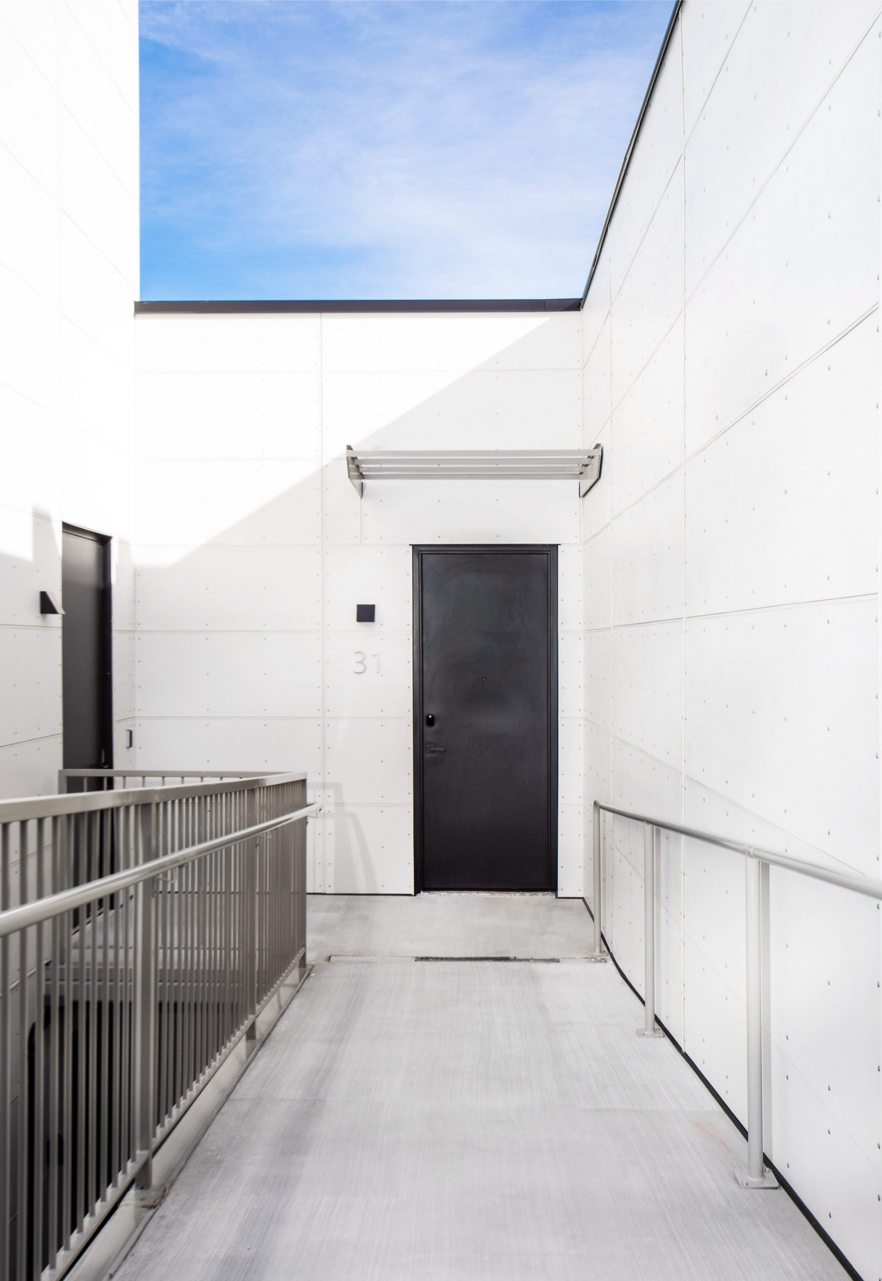 Walkway and door, Prospector Residential, architectural design by Elliott Workgroup