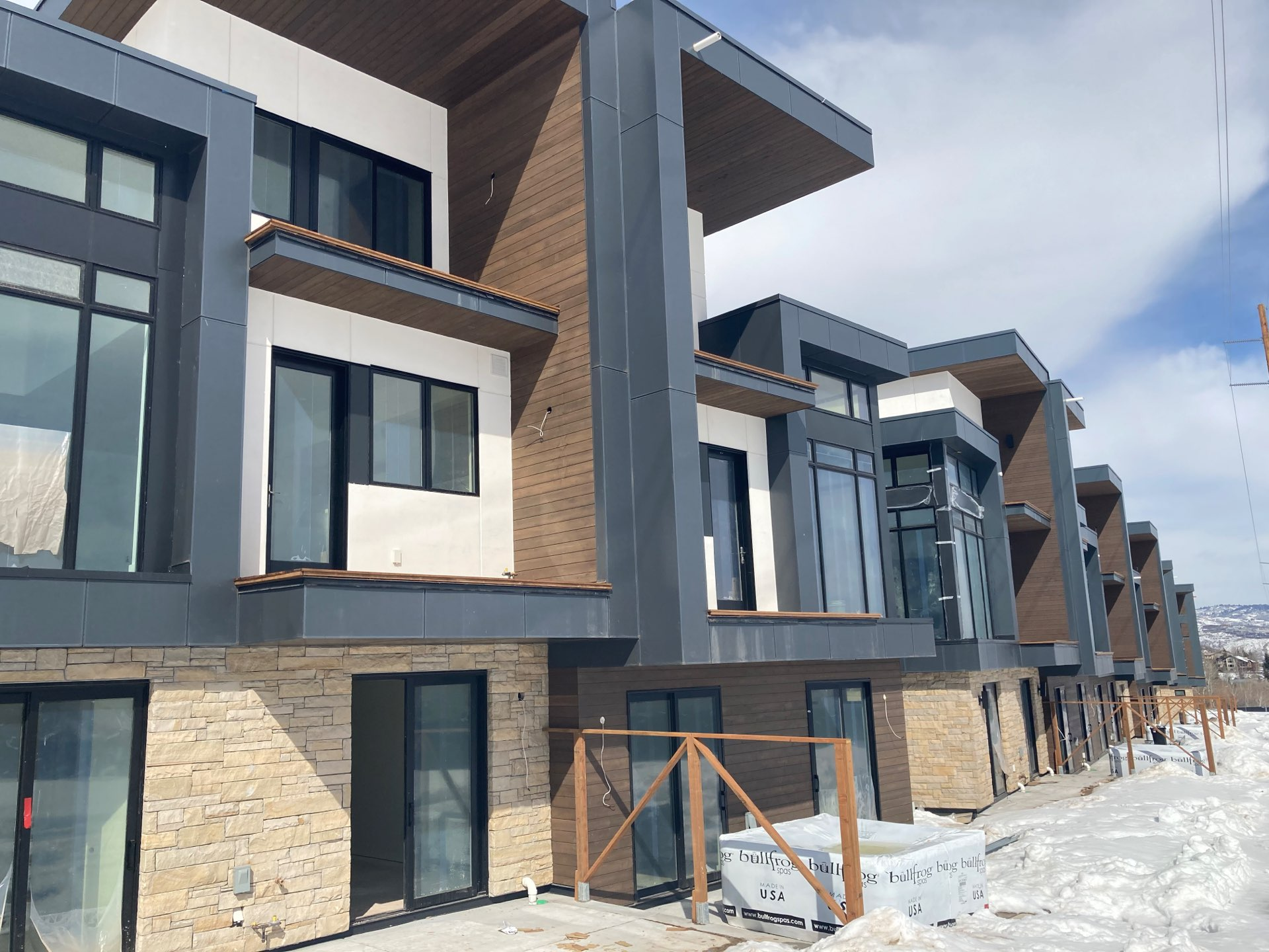 Unfinished exterior of Viridian Townhomes at Canyons Village in Park City, Utah, architectural design by Elliott Workgroup