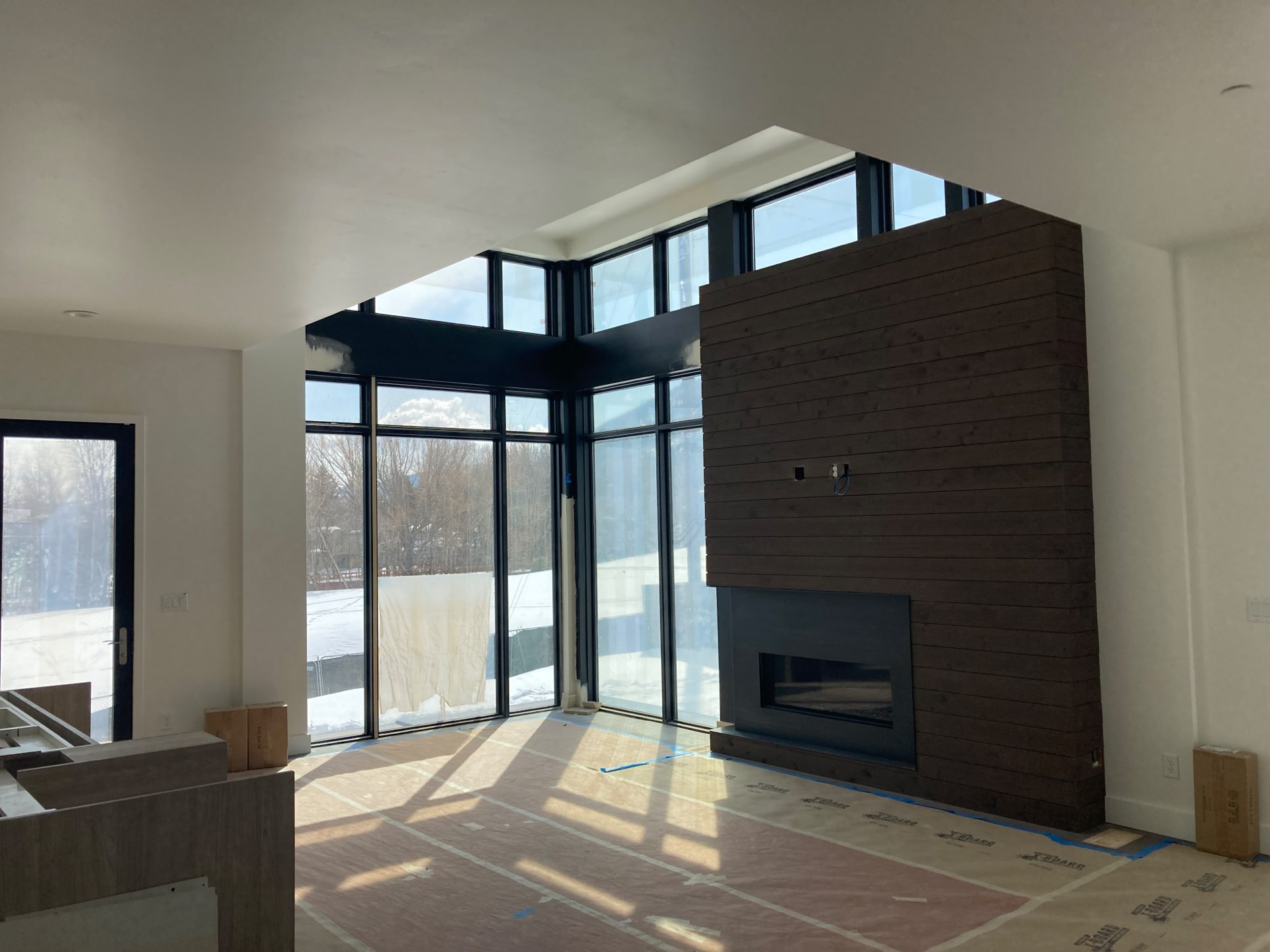 Unfinished living room in Viridian Townhomes at Canyons Village in Park City, Utah, architectural design by Elliott Workgroup