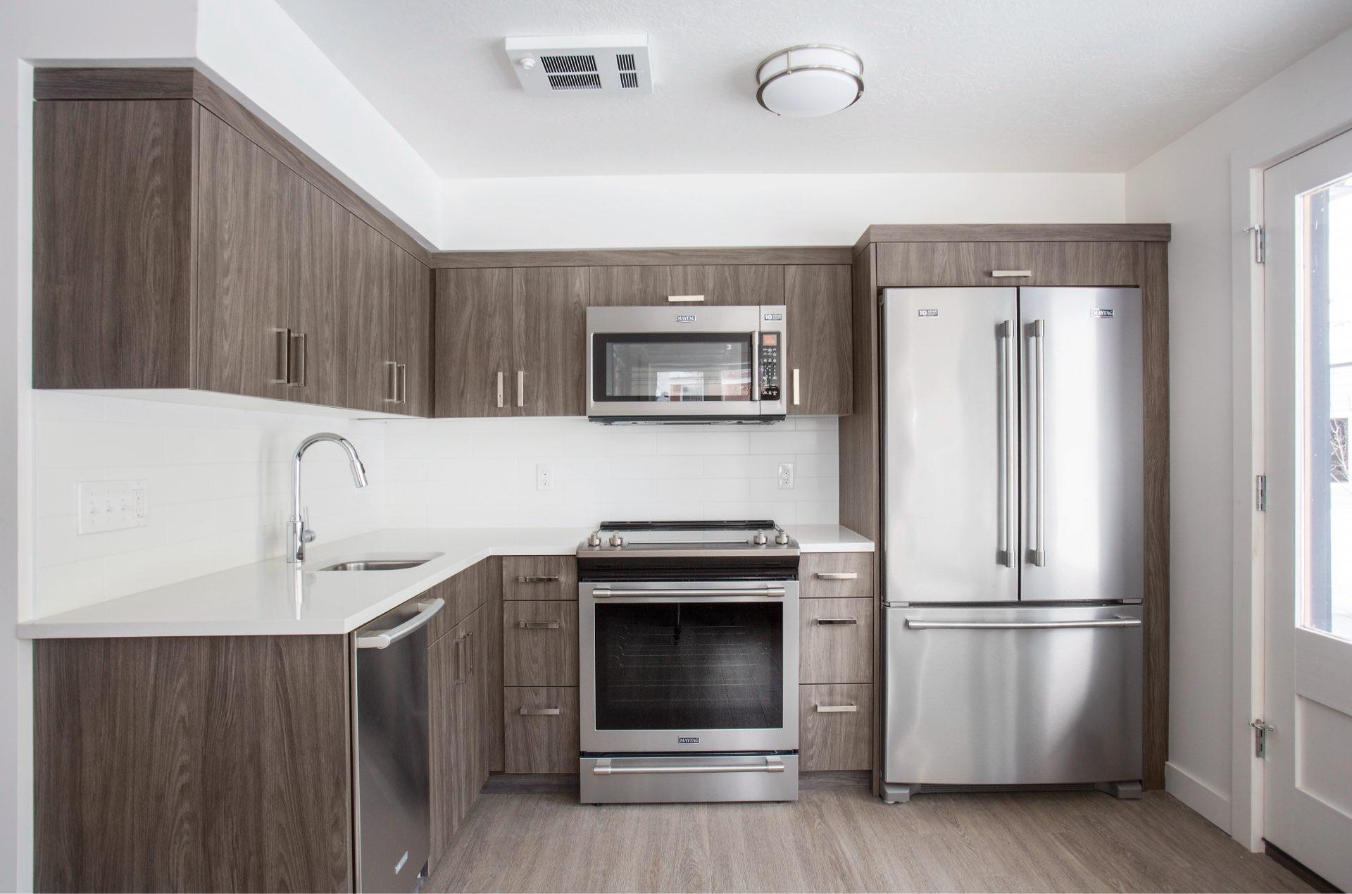 Kitchen, Woodside Park Affordable Housing, architectural design by Elliott Workgroup