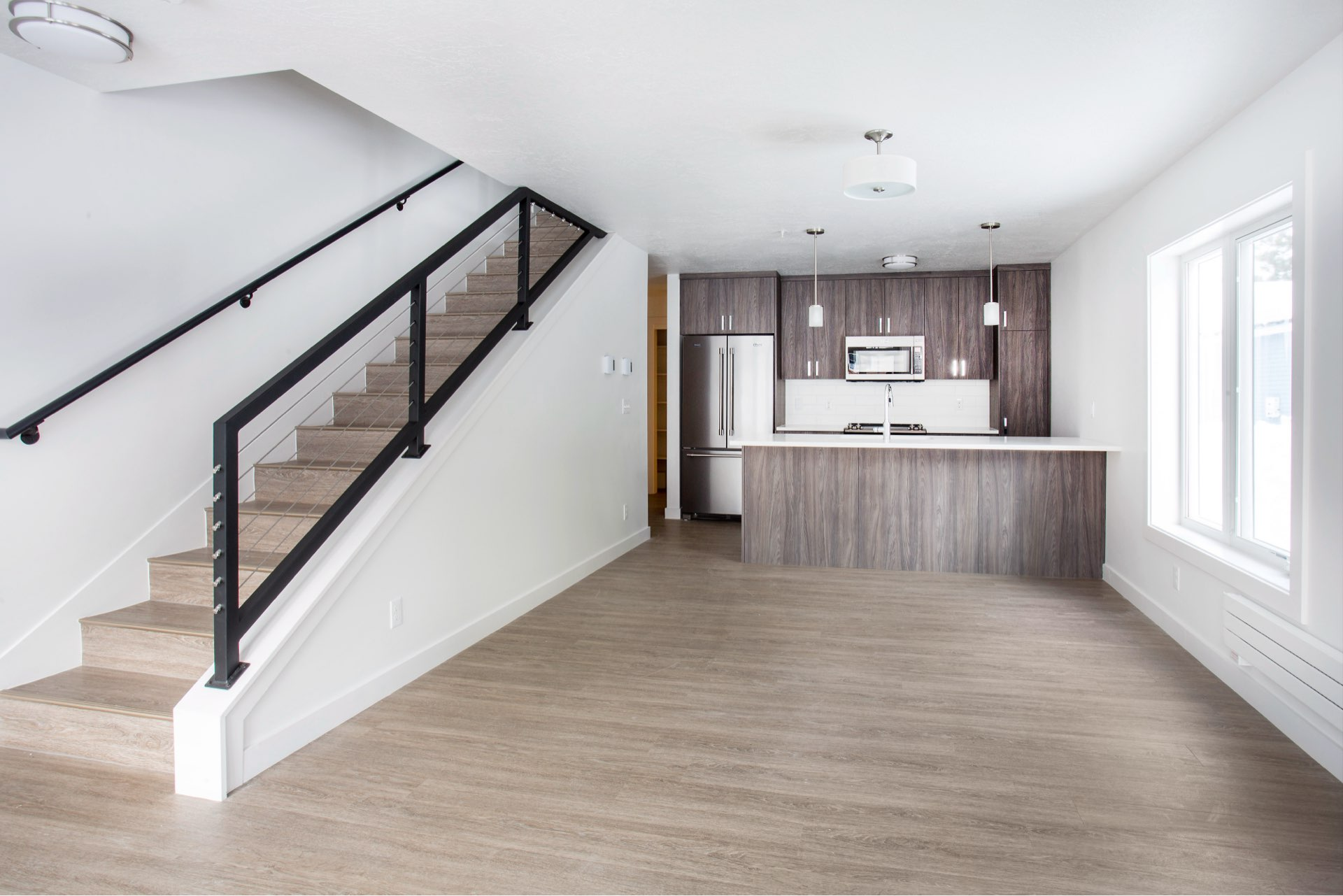 Kitchen and stairs, Woodside Park Affordable Housing, architectural design by Elliott Workgroup